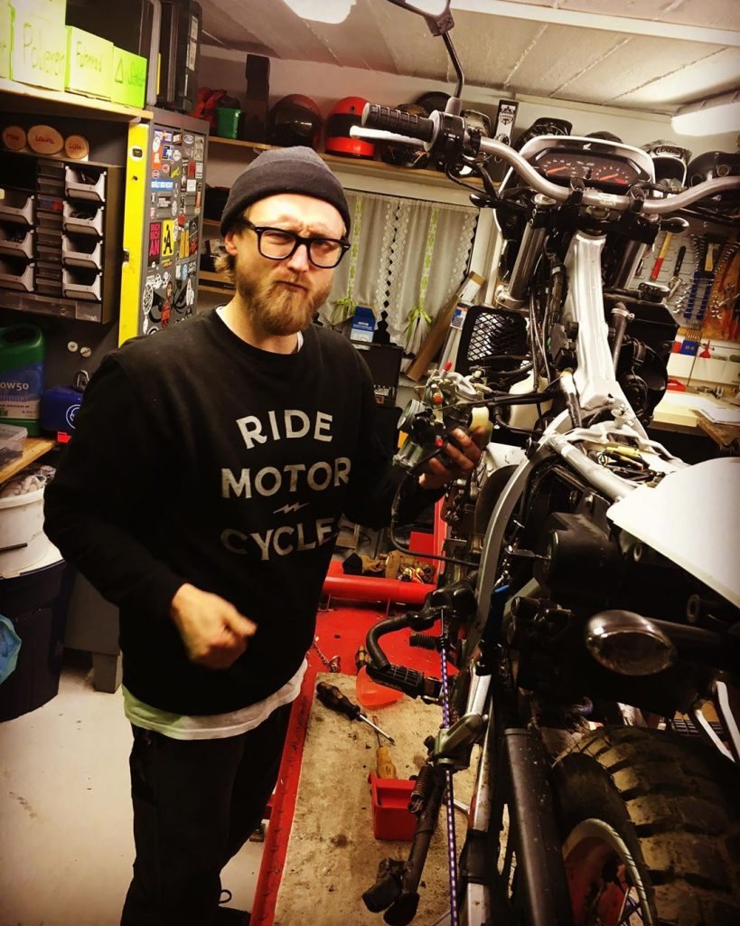 wrenching the motorcycle in the garage